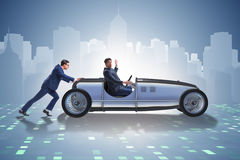 The businessman car pushing in teamwork concept Stock Photo