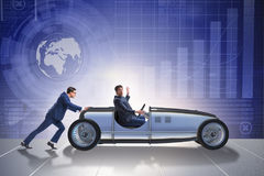 The businessman car pushing in teamwork concept Royalty Free Stock Image
