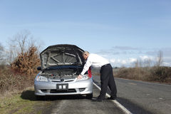 Businessman with car trouble Stock Image