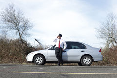 Businessman with car trouble Royalty Free Stock Photo