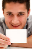 Businessman with card. A young and happy businessman shows a white business-card to us Stock Image