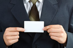 Businessman with card Royalty Free Stock Image