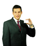 Businessman with Card. Young Male in Suit with a Blank Business Card Royalty Free Stock Images