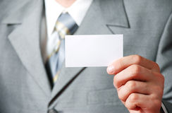 The businessman and the card. The businessman represents the card Stock Photos