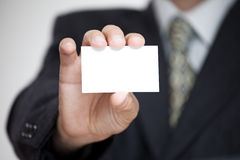 Businessman with card Stock Image