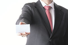 Businessman with card. Businessman in a suit and business card Stock Photos