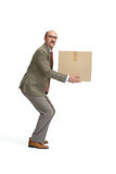 Businessman and a cardboard box. On a white background Royalty Free Stock Photography