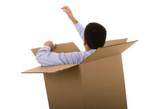 Businessman in a cardboard box Stock Images
