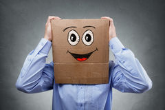Businessman with cardboard box on his head royalty free stock photos