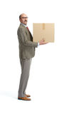Businessman and a cardboard box. On a white background Royalty Free Stock Images