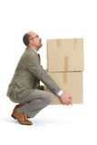 Businessman and a cardboard box Stock Image