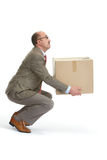 Businessman and a cardboard box. On a white background Royalty Free Stock Photo
