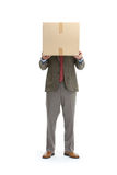Businessman and a cardboard box Royalty Free Stock Photography