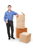 Businessman with Cardboard Boxes Royalty Free Stock Photography