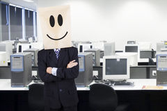 Businessman with cardboard head smiling 1 Royalty Free Stock Photos