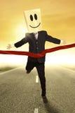 Businessman with cardboard head winning Stock Image