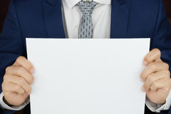 Businessman carries blank paper page Royalty Free Stock Images
