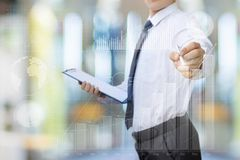 Businessman carries out the Analytics on statistical charts. Business man carries out the Analytics on statistical charts Royalty Free Stock Photos