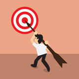 Businessman carry arrow on shoulder point to dartboard, concept Royalty Free Stock Photo