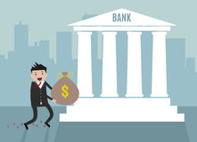 Businessman carry bank into bank. Royalty Free Stock Photography