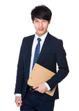 Businessman carry with clipboard Royalty Free Stock Image