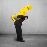 Businessman carry money symbol. Concrete background Stock Photo