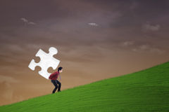Businessman carry puzzle piece Stock Photography