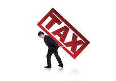 Businessman carry a tax sign. A businessman carry a tax sign on his back isolated on white Stock Photo