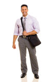 Businessman carrying bag Stock Images