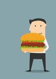 Businessman carrying a big hamburger Stock Photography