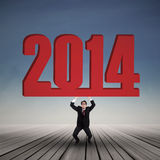 Businessman carrying a big number of 2014. Asian businessman carrying a big number of 2014 outdoor Stock Photography