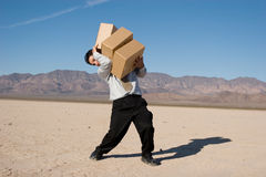Businessman carrying boxes Royalty Free Stock Photos