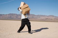 Businessman carrying boxes Stock Photography