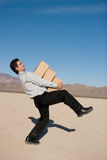 Businessman carrying boxes Royalty Free Stock Photography