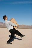 Businessman carrying boxes Stock Photos