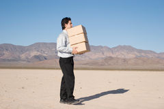 Businessman carrying boxes Royalty Free Stock Photo
