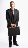 Businessman carrying briefcase Royalty Free Stock Photos
