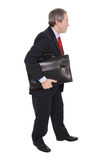 Businessman carrying a briefcase Stock Images