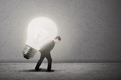 Businessman carry bright light bulb Stock Photo