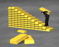 Businessman carrying bullion on gold in stairs stacking Royalty Free Stock Photo