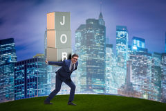 The businessman carrying the burden of his job Stock Photography