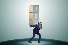 The businessman carrying the burden of his job Stock Image