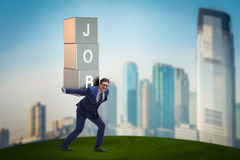 The businessman carrying the burden of his job Royalty Free Stock Image
