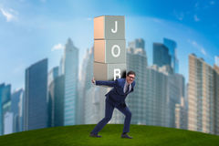 The businessman carrying the burden of his job Royalty Free Stock Photography