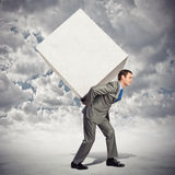 Businessman carrying cube Royalty Free Stock Photo