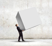 Businessman carrying cube Stock Image