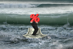 Businessman carrying 3D percentage on money boat with oncoming w Stock Images