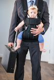 Businessman carrying daughter and briefcase Royalty Free Stock Image