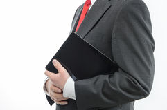 Businessman carrying digital tablet Stock Photography