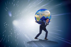 The businessman carrying earth on his shoulders. Businessman carrying Earth on his shoulders Stock Photography